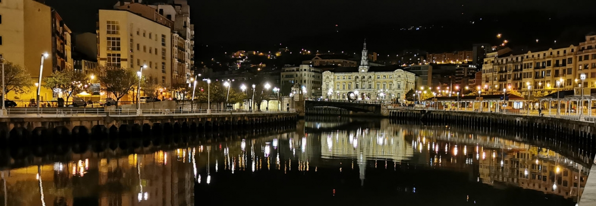 Bilbao night Nervion river and Town Hall